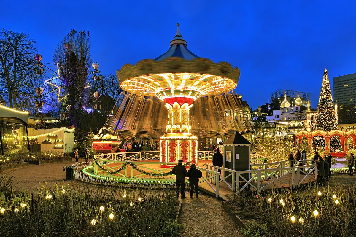 Evening view of carousel and christmas illumination in Tivoli Gardens, a famous amusement park and pleasure garden in Copenhagen, Denmark